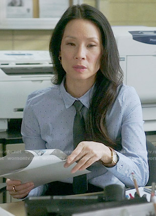 Joan's blue stripe and dot shirt on Elementary