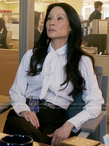 Joan's white neck bow blouse on Elementary