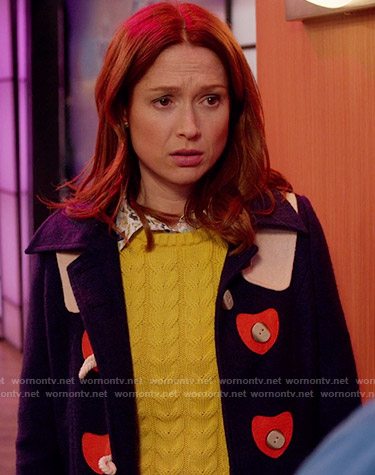 Kimmy's navy toggle coat with red hearts on Unbreakable Kimmy Schmidt
