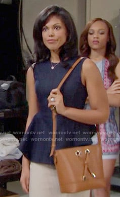 Maya's navy peplum top and tan bag on The Bold and the Beautiful