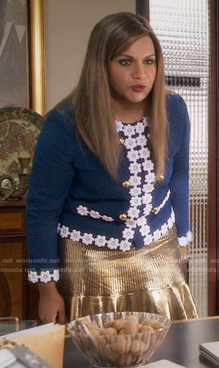 Mindy's navy blue flower trimmed jacket and gold skirt on The Mindy Project