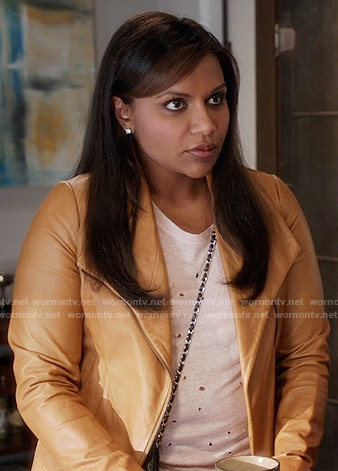 Mindy's white distressed t-shirt and tan leather jacket on The Mindy Project