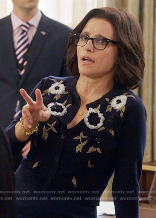 Selina's navy floral applique cardigan on Veep