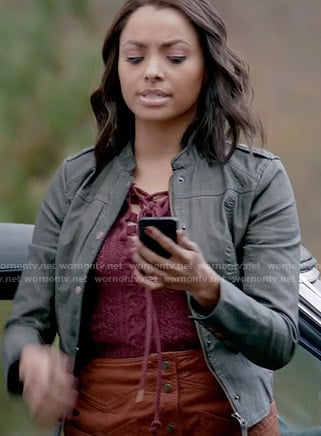 Bonnie's pink lace up sweater, leather jacket and tan button front skirt on The Vampire Diaries