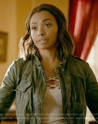 Bonnie's white lace-up top and grey leather jacket on The Vampire Diaries