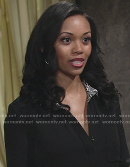 Hilary's black blouse with contrast print on The Young and the Restless