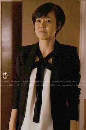 Karen's white top with black tie front on Mistresses