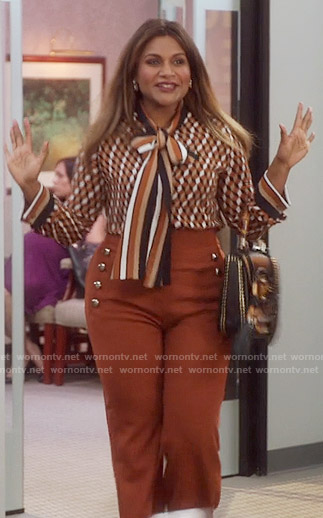 Mindy's brown front button trousers and printed tie neck blouse on The Mindy Project