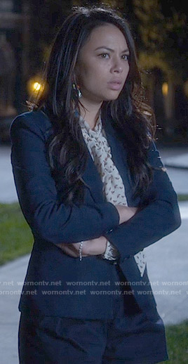 Mona's printed tie neck blouse and navy shorts on Pretty Little Liars
