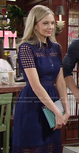 Abby's navy blue eyelet shirtdress and gingham clutch on The Young and the Restless