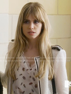 Brooke's feather print top and white textured jacket on Scream
