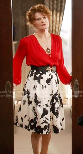 Evelyn's red blouse and black and white floral skirt on Devious Maids