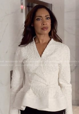 Jessica's white textured peplum jacket on Suits