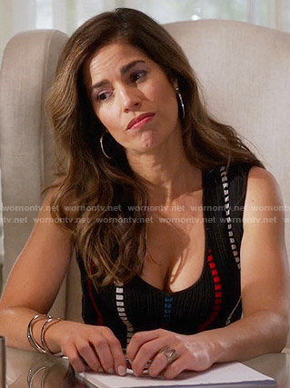 Marisol's black top with red and white dotted stripes on Devious Maids
