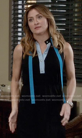 Maura's black dress with blue pearl button placket on Rizzoli and Isles