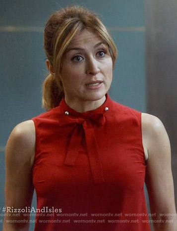 Maura's red tie neck top with pearls on Rizzoli and Isles