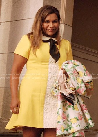 Mindy's yellow dress with white lace panel and tie neck and floral coat on The Mindy Project