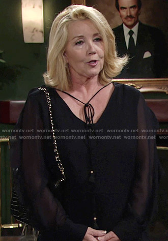 Nikki's navy blouse with sheer sleeves on The Young and the Restless