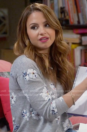 Sofia's grey floral sweater on Young and Hungry