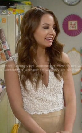 Sofia's white lace crop top and suede skirt on Young and Hungry