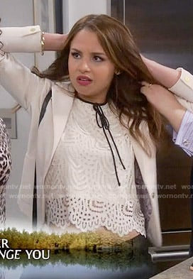 Sofia's white lace top with black tie neck on Young and Hungry