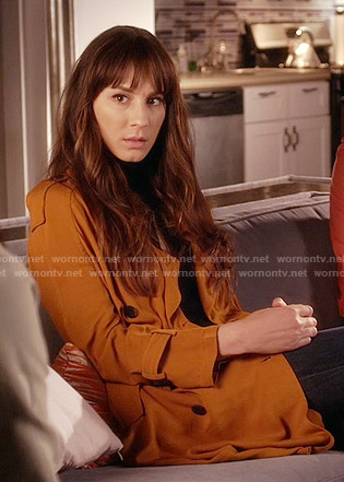 Spencer's orange trench coat on Pretty Little Liars