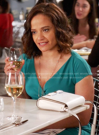 Zoila's green surplice neck dress and white bag on Devious Maids