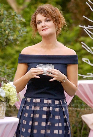 Evelyn's navy off-shoulder top and windowpane skirt on Devious Maids