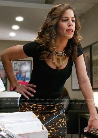 Marisol's yellow printed zip front skirt on Devious Maids