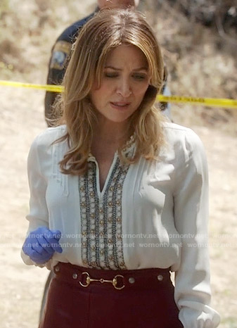 Maura's white embellished blouse and red pleated leather skirt on Rizzoli and Isles