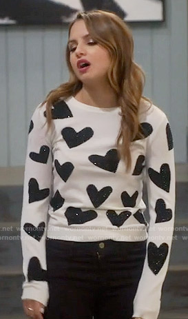 Sofia's black and white heart sweater on Young and Hungry