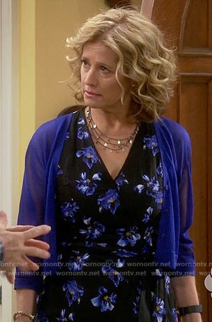 Vanessa's black and blue floral dress on Last Man Standing