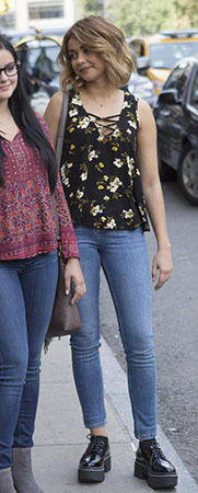 Haley's black floral strappy front top on Modern Family