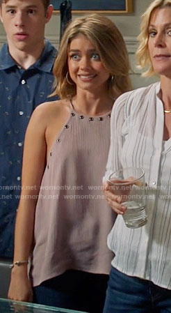 Haley's pink grommet trim top on Modern Family