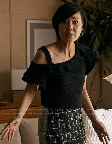 Karen's black ruffled tweed top and checked skirt on Mistresses