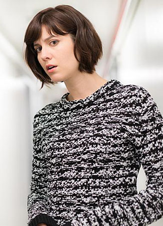 Laurel's black and white knit sweater on BrainDead