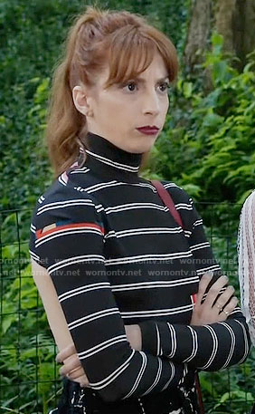 Lauren's black striped long sleeve top with cutout back on Younger