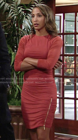 Lily's orange dress with side zip and leaf earrings on The Young and the Restless