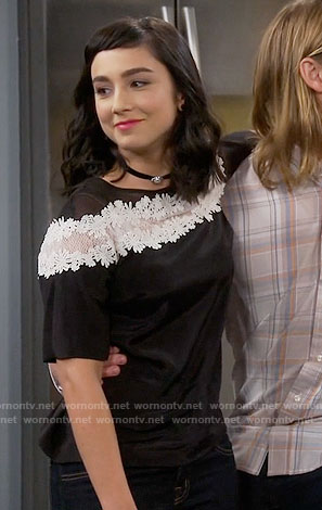 Mandy's black top with white lace stripe on Last Man Standing