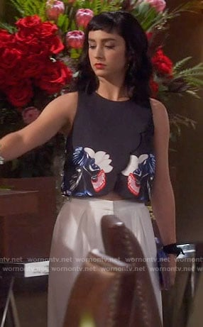 Mandy's black embroidered crop top and white wide leg pants on Last Man Standing