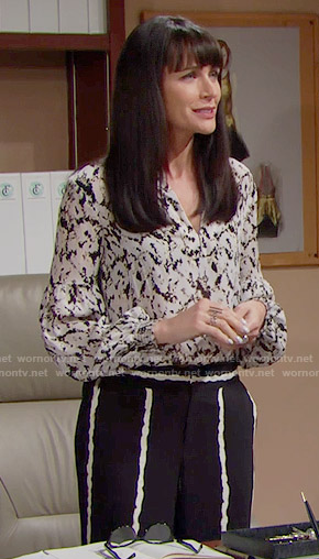 Quinn's black and white striped trousers and floral blouse on The Bold and the Beautiful