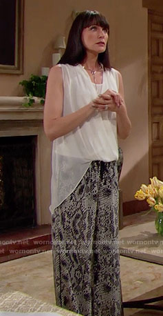 Quinn's white draped top and snake print pants on The Bold and the Beautiful