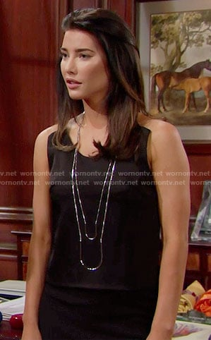 Steffy's black dress with clear straps and layered necklace on The Bold and the Beautiful