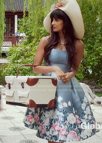 Tahani's blue rose printed full skirt dress and picnic basket on The Good Place