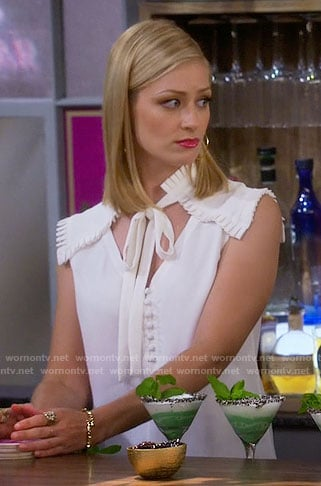 Caroline's white tie neck top with pleated shoulders on 2 Broke Girls