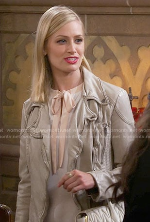 Caroline's white top with blush tie neck on 2 Broke Girls