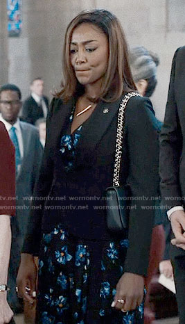 Daisy's black and blue floral dress on Madam Secretary