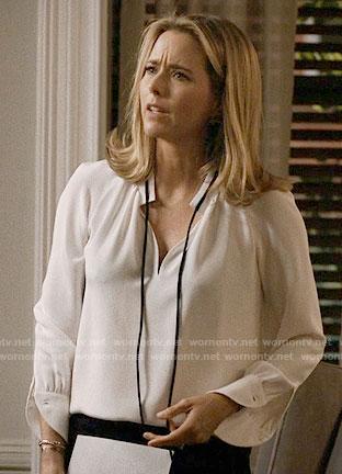 Elizabeth's white blouse with black tie neck on Madam Secretary