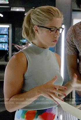 Felicity's blue sleeveless mock neck top on Arrow