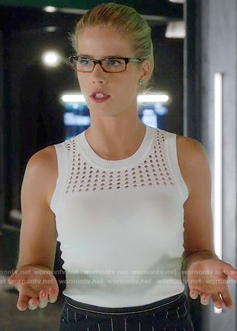 Felicity's white knit top and pinstriped skirt on Arrow